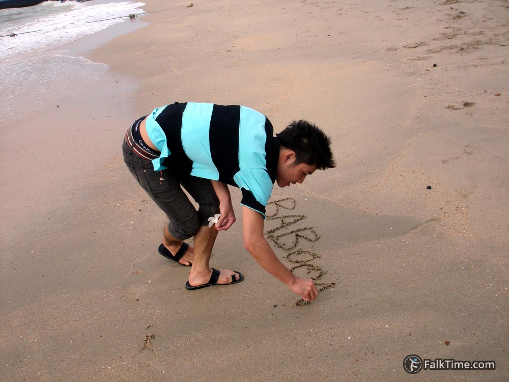 Thai is writing on the sand
